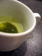 Green tea brewing in a cup