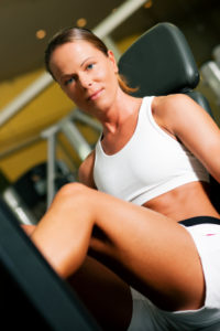 Young lady using a leg press