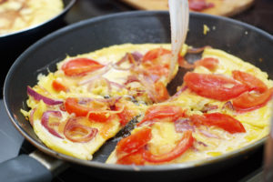 Large omelette with tomatoes